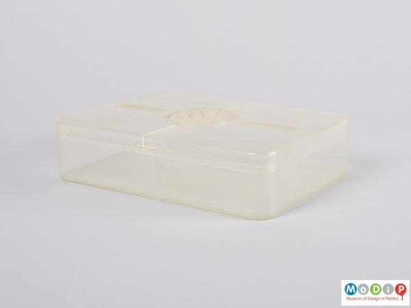 Side view of a food storage box showing the straight sides and rounded corners.
