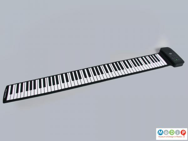 Front view of a piano showing the full length keyboard.