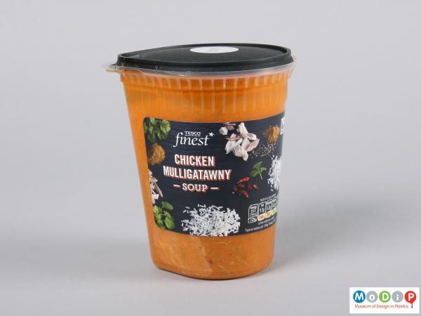 Side view of a soup pot showing the contents and adhesive label.