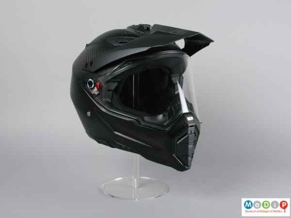 Front view of a helmet showing the peak and visor.