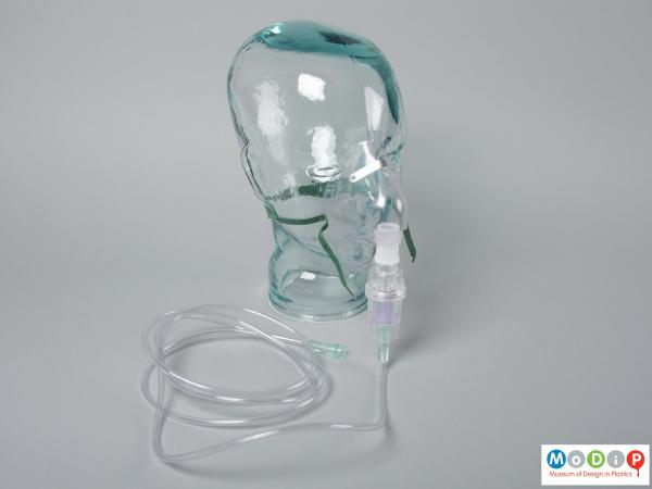 Side view of a nebuliser mask showing it with the chamber and tubing.