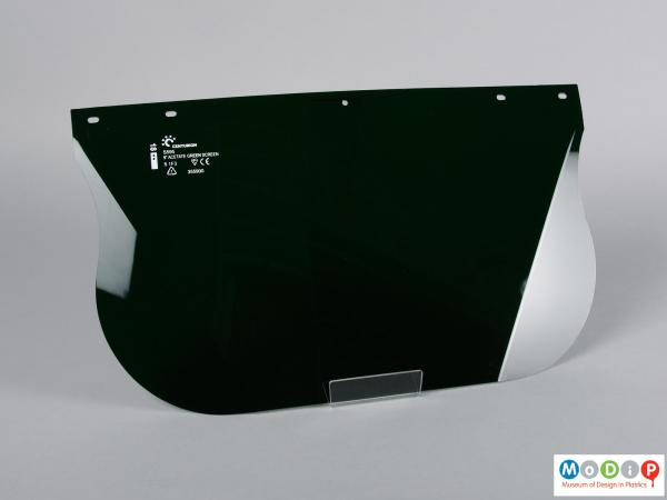 Front view of a safety visor showing the scored corners.