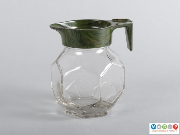 Side view of a jug showing the hexagonal shaped glass body.