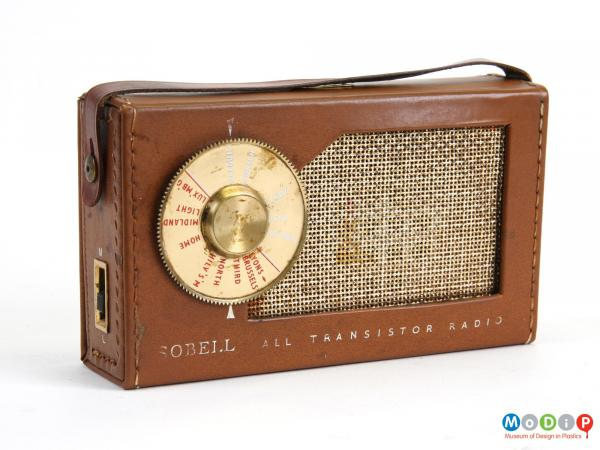 Front view of a Sobell All transistor radio, showing a sewn leatherette cover and a round dial.