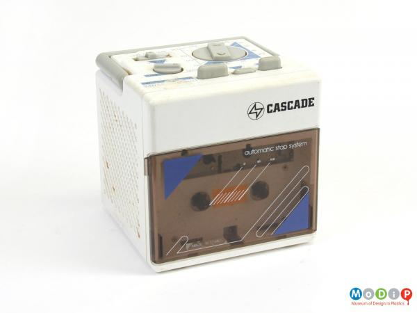 Front view of a radio cassette player showing the cassette cover.