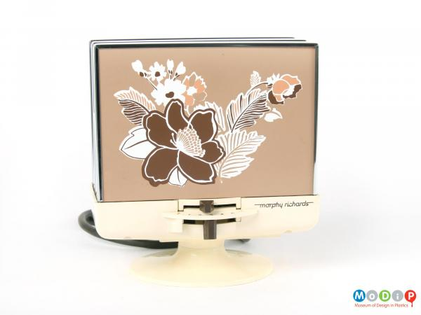 Front view of a Morphy Richards toaster showing the flower motif amd pedastal foot.