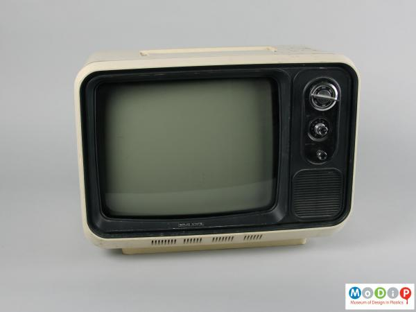 Front view of a television showing the black screen surround and dial controls.