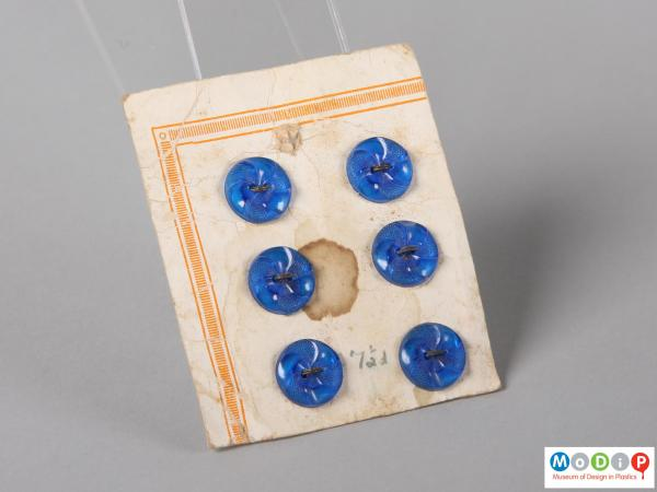 Front view of a sales card of royal blue buttons showing three rows of two buttons.