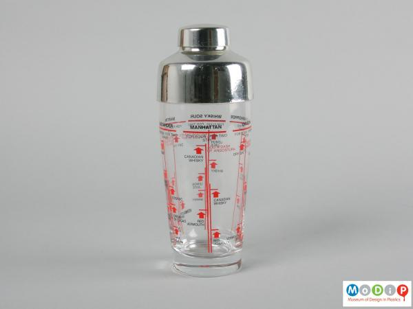 Side view of a cocktail shaker showing the printed information running around the surface.