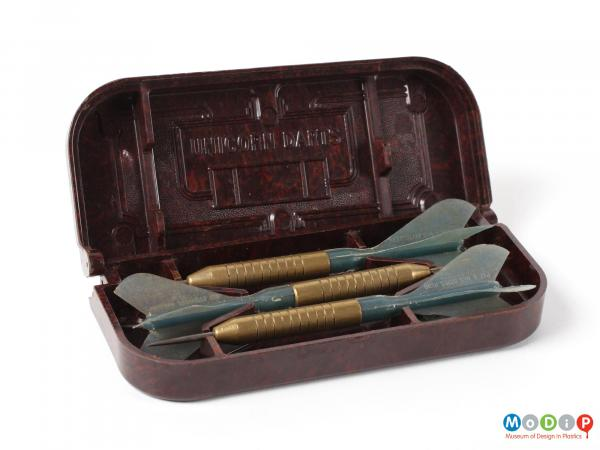 Front view of Unicorn darts box showing the box open with the three darts inside.