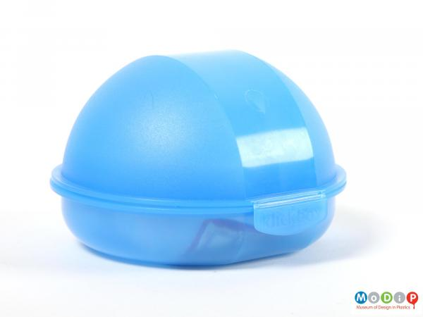 Front view of a blue bun box showing the clasp at the front closed.