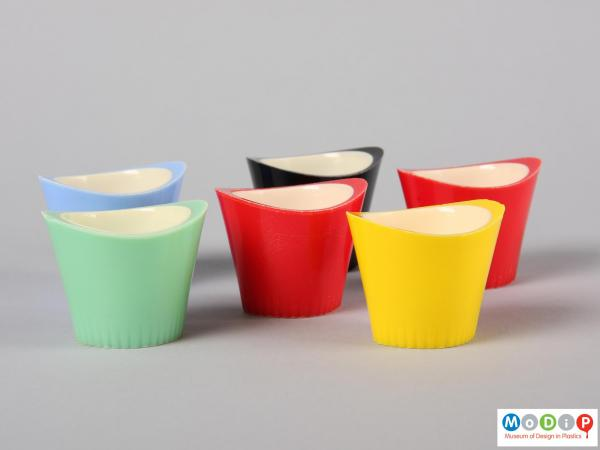 Side view of six Paramount egg cups showing the oval shape and the raised sides of the egg cup.