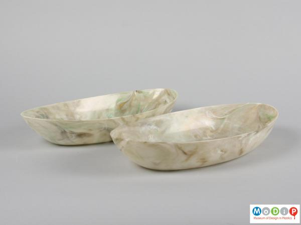 Side view of a pair of oval fruit bowls showing the straight sides.
