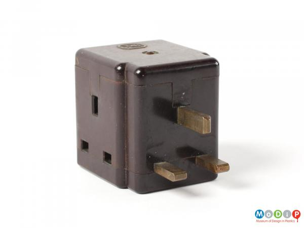 Side view of an IRL 3-pin plug adapter showing the 3 pins at the front and one of the sockets on the side.