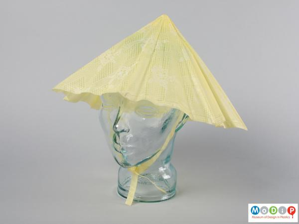 Front view of a rain hat showing the triangular shape.