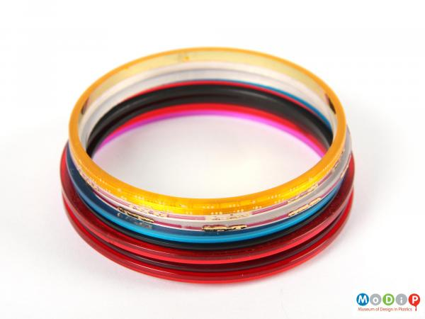 Side view of a set of bangles showing them piled up to show the different colours.