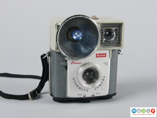 Front view of a camera showing the large flash.