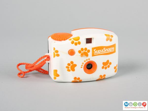 Front view of a camera showing paw print decoration.