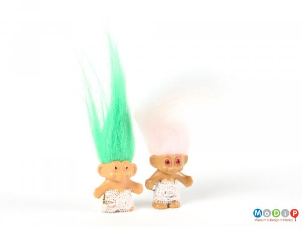 Front view of 2 trolls showing the long green and pale pink hair.