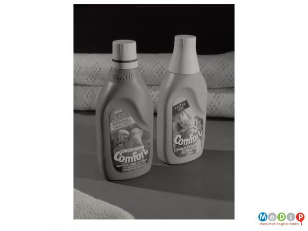 Scanned image showing two bottles of comfort with blankets in the background.