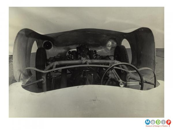 Scanned image showing a car body.