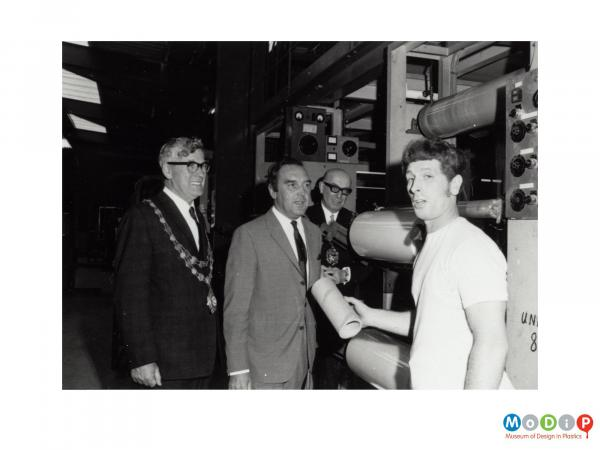 Scanned image showing a mayoral visit to a factory.