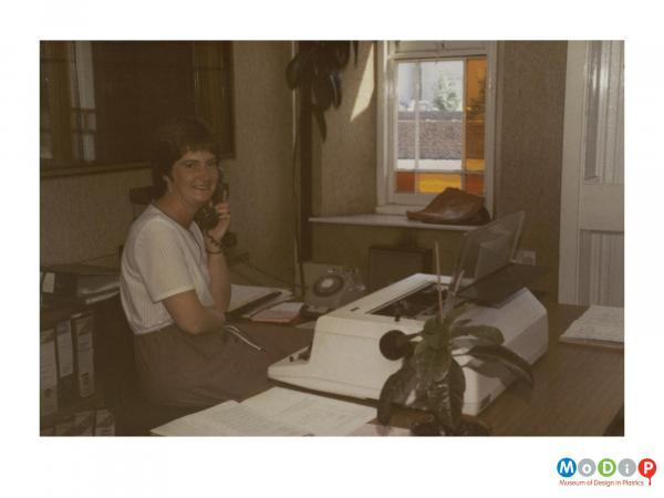 Scanned image showing a female office worker.