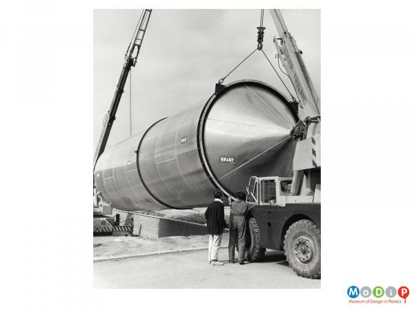 Scanned image showing a large storage tank on its side.
