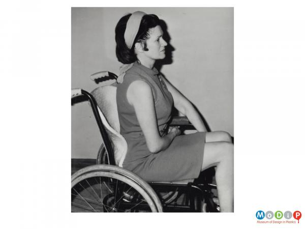 Scanned image showing a woman in a wheel chair.