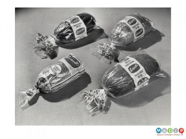 Scanned image showing four bags of bread.