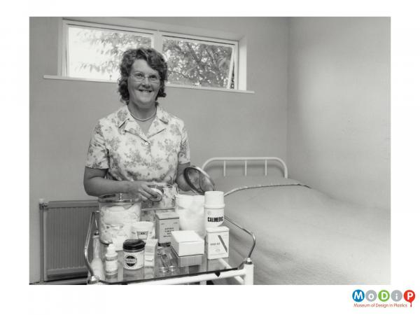 Scanned image showing a woman in a first aid room