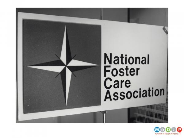 Scanned image showing panel made of Plastazote used to adverstise the National Foster Care Association.