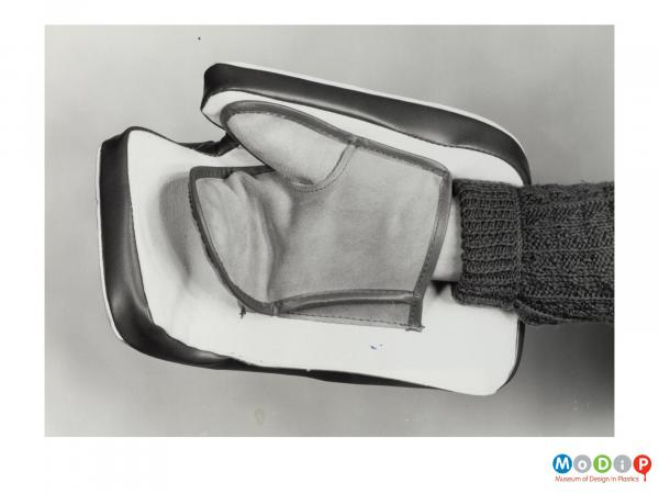 Scanned image showing a padded glove.