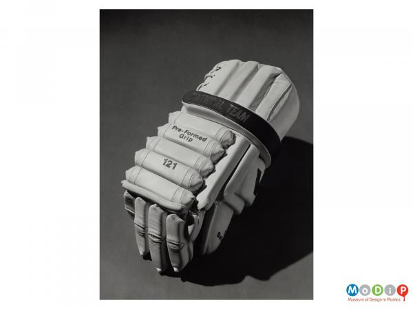 Scanned image showing the back of an ice hockey glove.