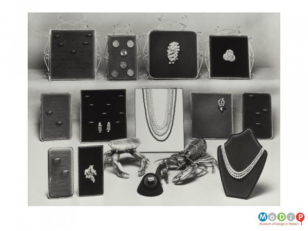 Scanned image showing a range of jewellery display boards.