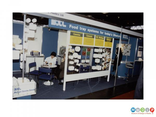 Scanned image showing a food tray diplay stand.