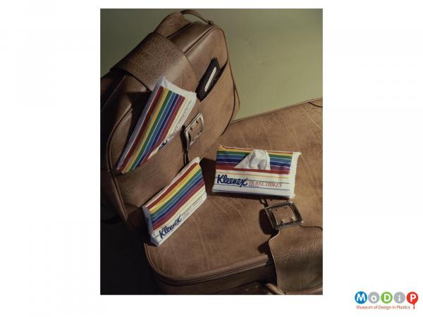 Scanned image showing packets of travel tissues alongside luggage.