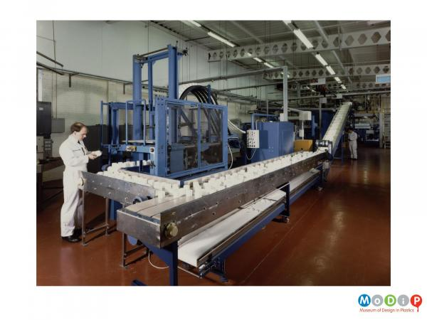 Scanned image showing packaging on a production line.