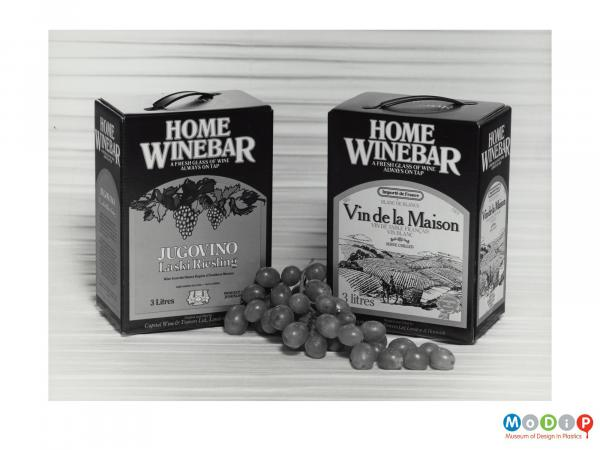 Scanned image showing two boxes of wine.