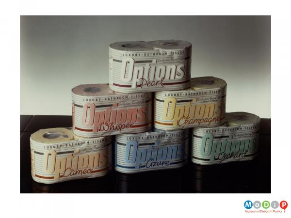 Scanned image showing a range of different coloured packaging for toilet roll.