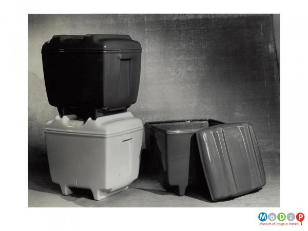 Scanned image showing three lidded boxes.