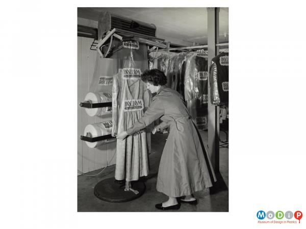 Scanned image showing a machine to assist with covering garments after dry cleaning.