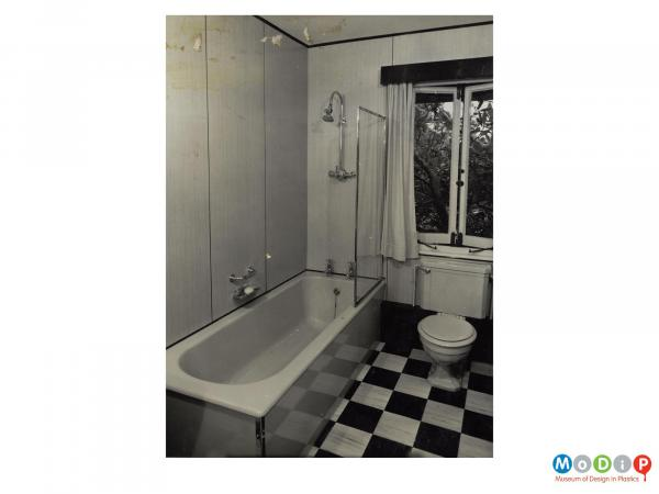 Scanned image showing wall panels in a bathroom setting.