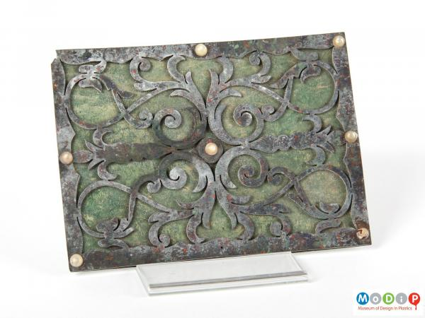 Front view of a parkesine panel showing the wrought iron effect achieved by the material.