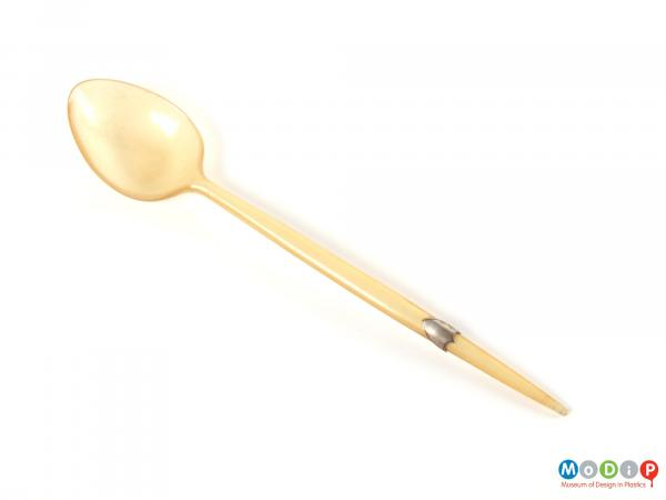 Top view of a spoon showing the bowl and handle.