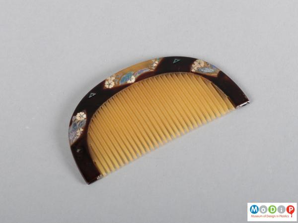 Top view of a comb showing the heading and teeth.