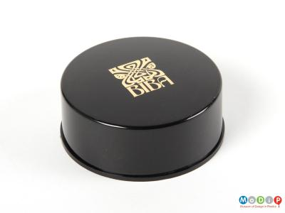 Top view of a Biba face powder box showing the smooth sides and the printed logo on the lid.