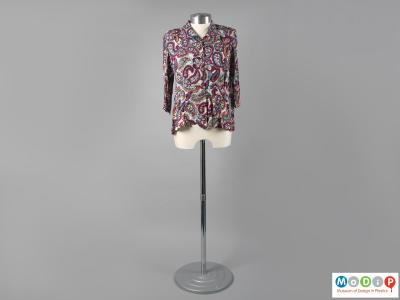Front view of a blouse showing the colourful fabric.