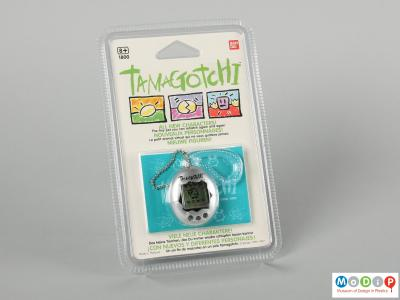 Front view of a Tamagotchi showing toy in its original packaging.