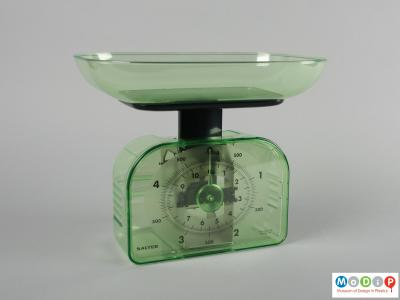 Front view of a kitchen scale showing the dial face.